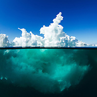 Canada, Nunavut Territory, Underwater view of melting iceberg floating in Hudson Bay on summer morning