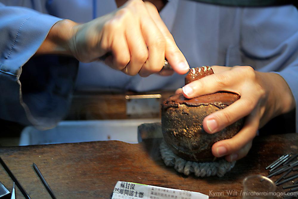 Asia, China, Hong Kong. Jeweler setting stones at Aberdeen Jewelers.