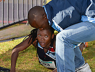 EAST LONDON, SOUTH AFRICA - FEBRUARY 20: Patience Khumalo of Athletics Gauteng North (AGN) crashes after winning the women's race during the ASA Marathon Championships in East London on February 20, 2015 in South Africa. (Photo by Roger Sedres/Gallo Images)