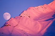 Alaska. Chugach Mts. Girdwood. Moonrise above Mt Alyeska.