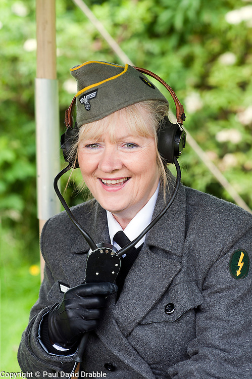reenactor dressed as German army female signals auxiliary (Nachrichtenheflrennin des heeres) also nicknamed Blitzm&auml;dchen or lightening girls because of the signals insignia on their uniforms. <br /> Stanhope War on the line Weardale Railway Co Durham<br /> 14 July 2012<br /> Image &copy; Paul David Drabble