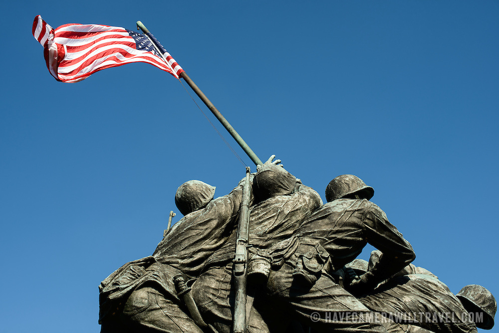 Looking up at the Iwo Jima Memorial (formally the Marine Corps War Memorial) in Arlington, Virginia, next to Arlington National Cemetery. The monument was designed by Felix de Wledon and is based on an iconic Associated Press photo called the Raising the Flag on Iwo Jima by Joe Rosenthal. It was dedicated in 1954.