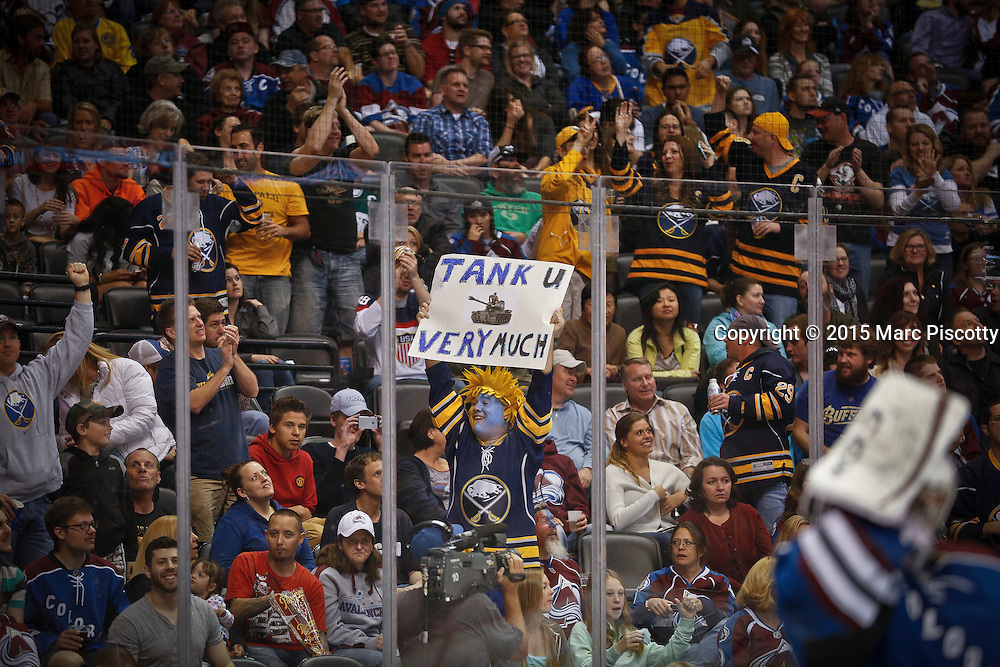 """SHOT 3/28/15 9:07:27 PM - Buffalo Sabres fans celebrate a goal by their team with a """"Tank You Very Much"""" sign during their regular season NHL game against the Colorado Avalanche at the Pepsi Center in Denver, Co. The Avalanche won the game 5-3. Many Sabres fans are in favor of the team losing out to secure one of the top two draft picks in the upcoming NHL Draft. (Photo by Marc Piscotty / © 2015)"""
