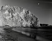 BW01889-00...WASHINGTON - Moon over Hole-In-The-Wall, Olympic National Park. This is an Ilford Delta 100 4x5 film image.