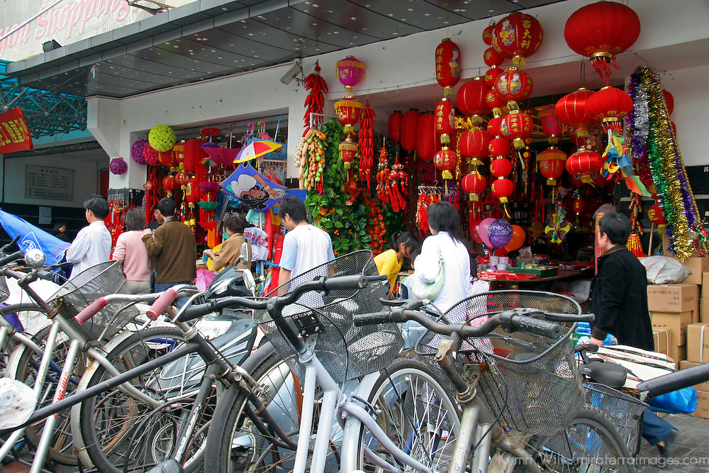Asia, China; Shanghai. Bike racks and storefronts of a bustling Shanghai street.