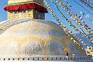 Throwing colored water on the stupa at Bodhnath.