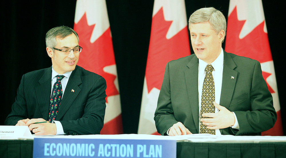 Prime Minister Stephen Harper, right, and Industry Minister Tony Clement attend at a round table meeting at the Spencer Leadership Center, part of the Richard Ivey School of business in London, Ontario, March 25, 2010.<br /> REUTERS/Geoff Robins(CANADA/)