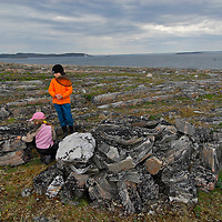 Opingivik Island. Baffin Island South. Evidence found nearby show that the Thule culture, ancestors of todays inuits lived here. , Burial made with rocks