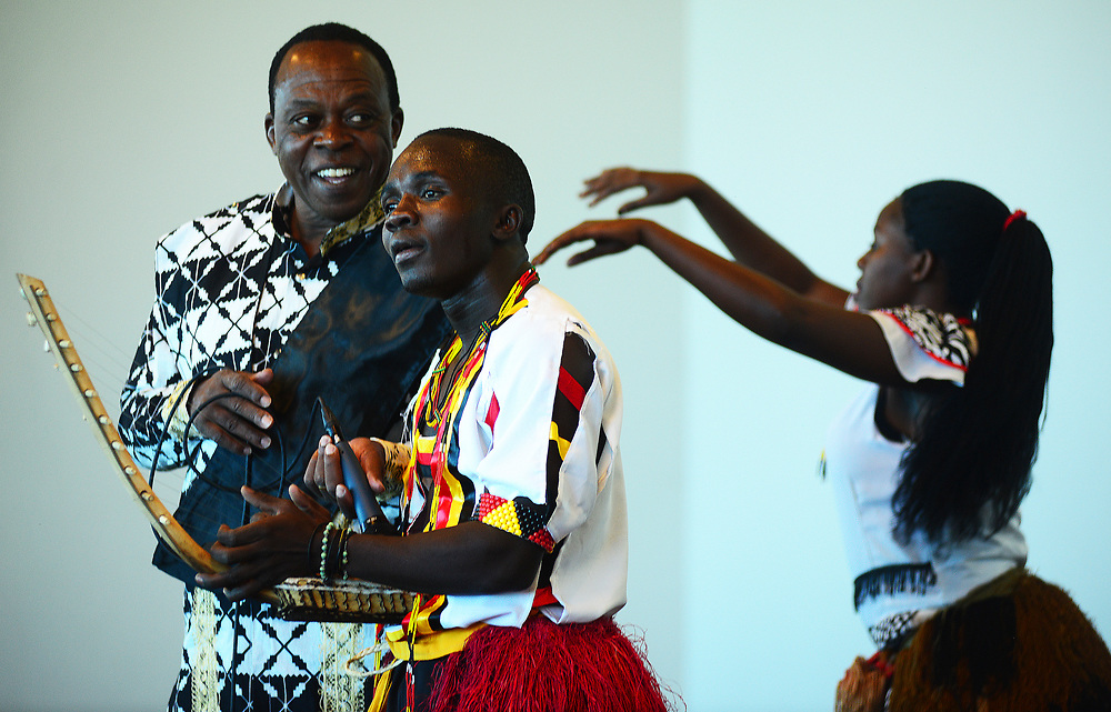 apl030117f/ASECTION/pierre-louis/030117/JOURNAL<br /> From left  Uganda's Ndere Troupe founder Rwangyezi Stephen , , James Kalamya,, on Adungu (harp) and dancer Norah Namusoke,,  perform at the Balloon Fiesta Museum .Photographed  on Wednesday March 1, 2017. .Adolphe Pierre-Louis/JOURNAL