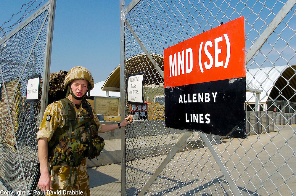 A British soldier, from the Muliti National Division (MND SE) mans a security gate at Allenby Lines on Basra Air Station during Operation Telic in March 2005