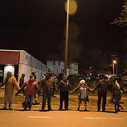 Protestors with the Black Lives Matter movement gather for a night of community and protest outside the Minneapolis Police Department 4th precinct headquarters on Thursday, November 19, 2015 in Minneapolis, Minnesota. <br /> <br /> A more mellow and festive atmosphere, with a smaller police presence, prevailed after Wednesday evening's tear gas clashes between police and protesters. <br /> <br /> Protests and an encampment at the site have been ongoing since the police shooting of 24-year-old Jamar Clark by Minneapolis Police on Sunday, November 15. <br /> <br /> <br /> Photo by Angela Jimenez for Minnesota Public Radio www.angelajimenezphotography.com