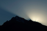 Sunrise silhouette of the southwest ridge of Churup Oeste (West) 5,493m, viewed from Huaráz.  Nikon D200, 70-200/2.8.