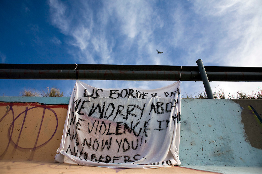 "A banner that says ""US BORDER PATROL WE WORRY ABOUT VIOLENCE IN MEXICO AND NOW YOU!! MURDERERS.VIVA MEXICO."" The banner was a protest against the killing of 15-year-old Sergio Adrian Hernandez Guereca, who was killed yesterday by a Border Patrol agent. The banner was hung on the Mexican side between the ""Puente Juarez"" bridge and the ""Puente Negro"" bridge."