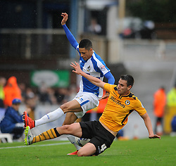 Daniel Leadbitter of Bristol Rovers is tackled by Josh Laurent of Newport County - Mandatory byline: Dougie Allward/JMP - 07966 386802 - 24/10/2015 - FOOTBALL - Memorial Stadium - Bristol, England - Bristol Rovers v Newport County AFC - Sky Bet League Two