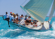 """356204-1161 ~ Copyright:  George H. H. Huey ~  """"Rupert's Legend"""", Class """"A"""" Bahamian sloop, w/ Mark Knowles at the helm,  sailing to windward at the annual National Family Island Regatta. George Town, Great Exuma Island, Bahamas."""