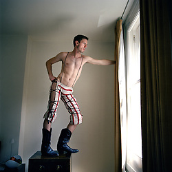 UK. London. Jake Shears, lead singer from the band The Scissor Sisters, in his hotel room in London..Photo©Steve Forrest