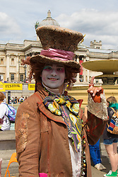 London, July 18th 2015.  A performer poses for a picture whilst awaiting his slot to perform in the Busk in London Festival aimed at showcasing the outstanding talents of many of the capital's finest street performers, including, musicians, magicians, living statues and bands.