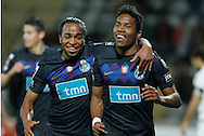 Portugal, FUNCHAL : Porto´s Brazilian Alex Sandro (R) celebrates after scoring against Nacional during their Portuguese league football match at Madeira Stadium in Funchal on March 16, 2012..PHOTO/ GREGORIO CUNHA.Estadio da Madeira, Funchal, Liga Portuguesa de futebol, Nacional vs Porto. .Alvaro e Alex Sandro.Foto Gregório Cunha