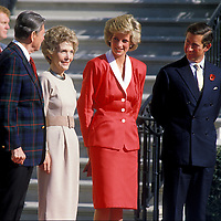 President Ronald and Nacy Reagan pose for photos upon the arrival of Princess Diana and Prince Charles at the White House in November 1985.