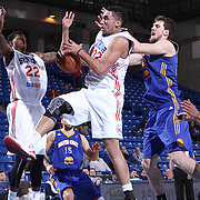 Delaware 87ers Forward Drew Gordon (32) drives towards the basket as Santa Cruz Warriors Center Ognjen Kuzmic (32) defends in the first half of a NBA D-league regular season basketball game between the Delaware 87ers and the Santa Cruz Warriors (Golden State Warriors) Tuesday, Jan. 13, 2015 at The Bob Carpenter Sports Convocation Center in Newark, DEL