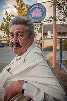 """Retired field worker Ramiro """"Ray"""" Espinoza on a park bench in downtown Calistoga.  """"I have worked all over Sanoma and Napa Counties...I have picked all kinds of fruits and vegetables and I ended up here in Calistoga."""""""
