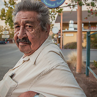 "Retired field worker Ramiro ""Ray"" Espinoza on a park bench in downtown Calistoga.  ""I have worked all over Sanoma and Napa Counties...I have picked all kinds of fruits and vegetables and I ended up here in Calistoga."""
