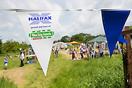 20140601 Free for editorial use image<br /> <br /> Halifax colleagues in Bournemouth are proud to give extra back to their local community by hosting their Big Lunch event on Sunday 01 June 2014.<br /> <br /> A general view of The Big Lunch at the New Leaf Allotment in Bournemouth. <br /> <br /> For more information please contact: Catherine Eastham on 020 3697 4304<br /> <br /> If you require a higher resolution image or you have any other onEdition photographic enquiries, please contact onEdition on 0845 900 2 900 or email info@onEdition.com<br /> This image is copyright the onEdition 2014&copy;.<br /> This image has been supplied by onEdition and must be credited onEdition. The author is asserting his full Moral rights in relation to the publication of this image. Rights for onward transmission of any image or file is not granted or implied. Changing or deleting Copyright information is illegal as specified in the Copyright, Design and Patents Act 1988. If you are in any way unsure of your right to publish this image please contact onEdition on 0845 900 2 900 or email info@onEdition.com