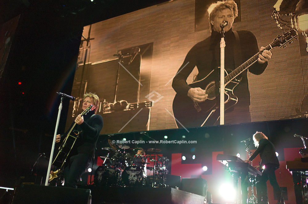 Bon Jovi performs at the 12-12-12 fundraising concert to aid the victims of Hurricane Sandy, will take place on December 12, 2012 at Madison Square Garden. The concert featured The Rolling Stones, Bon Jovi, Eric Clapton, Dave Grohl, Billy Joel, Alicia Keys, Chris Martin, Bruce Springsteen & the E Street Band, Eddie Vedder, Roger Waters, Kanye West, The Who, and Paul McCartney. All the proceeds went go to the Robin Hood Relief Fund. Robin Hood, the largest independent poverty fighting organization in the New York area, will insure that every cent raised will go to non-profit groups that are helping the tens of thousands.of people throughout the tri-state area who have been affected by Hurricane Sandy...Photo © Robert Caplin..