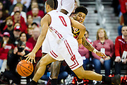 Guard Nate Mason, right, fights through a pick during the second half of the University of Minnesota Men's Basketball game versus University of Wisconsin on March 5, 2017.