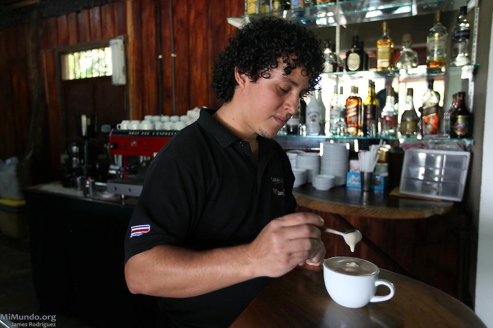 Marco Rodríguez Briseño, coffee shop server at COOCAFE's Plaza del Café Restaurant near the Arenal Volcano, prepares a hot coffee drink. COOCAFE, Tilarán, Guanacaste, Costa Rica. August 22, 2012.
