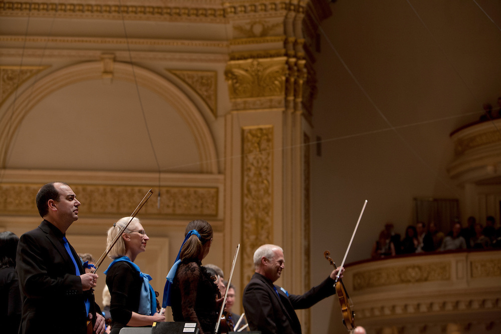 Members of the Seattle Symphony Orchestra greet the audience before performing John Luther Adams'  Become Ocean in the New York premiere during Spring for Music at Carnegie Hall in New York, NY on May 06, 2014.