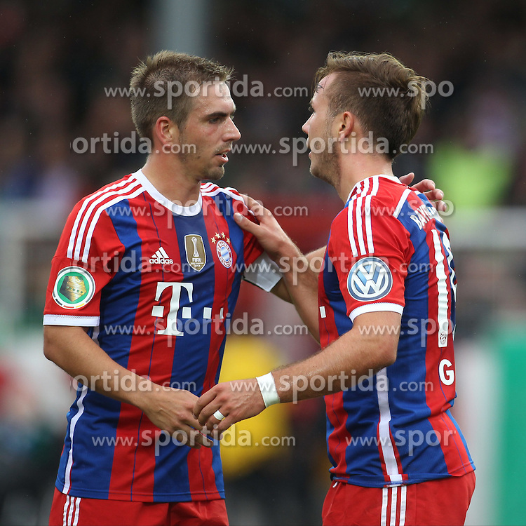 17.08.2014, Preussenstadion, Muenster, GER, DFB Pokal, SC Preussen Muenster vs FC Bayern Muenchen, 1. Runde, im Bild Kapitaen Philipp Lahm (FC Bayern Muenchen #21) und Torschuetze -Mario Goetze (FC Bayern Muenchen #19) beim Torjubel nach dem Treffer zum 1:0 // during the 1st round match of German DFB Pokal between SC Preussen Muenster vs FC Bayern Munich at the Preussenstadion in Muenster, Germany on 2014/08/17. EXPA Pictures &copy; 2014, PhotoCredit: EXPA/ Eibner-Pressefoto/ Schueler<br /> <br /> *****ATTENTION - OUT of GER*****