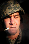 Staff Sergeant Nathan Lett smokes a cigarette during a break in combat tactics training at Charleston Air Force Base, S.C., on July 3, 2008.