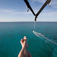 Bahamas, New Providence Island, Nassau, Elevated view while parasailing flight above Caribbean Sea near Cable Beach