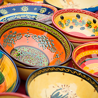 Colorful ceramic bowls on display at the market in L'isle-Sur-La-Sorgue