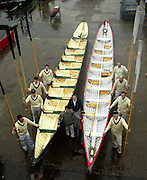 Richmond, Surrey, Specially commissioned boats built for the 150 year anniversary of the Varsity Boat Race to be raced on Boat Race day with selected crew members. The Cutters built at the Richmond Bridge Boat Houses. Crew member line up with their boats. [Mandatory Credit; Peter Spurrier / Intersport Images]