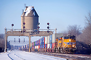 As the air temperature hovers around -15F, a Union Pacific intermodal train rolls toward Chicago, passing under the ancient steam-era coaling tower in Nelson, IL.