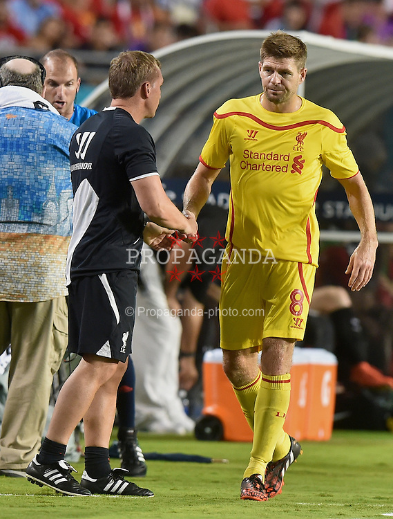 MIAMI, USA - Monday, August 4, 2014: Liverpool's captain Steven Gerrard is substituted by manager Brendan Rodgers during the International Champions Cup Final match against Liverpool at the SunLife Stadium on day fifteen of the club's USA Tour. (Pic by David Rawcliffe/Propaganda)