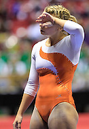 Columbus East senior Molly Boggs reacts after falling off to the balance beam during the IHSAA gymnastics state finals meet at Worthen Arena in Muncie, Indiana. (Michael Hickey | For The Republic)