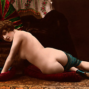 Vintage hand colored French erotic postcard, of reclining nude circa 1915