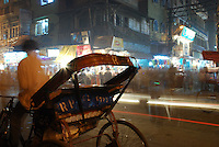 The busy streets of Old Delhi, India, after dark.