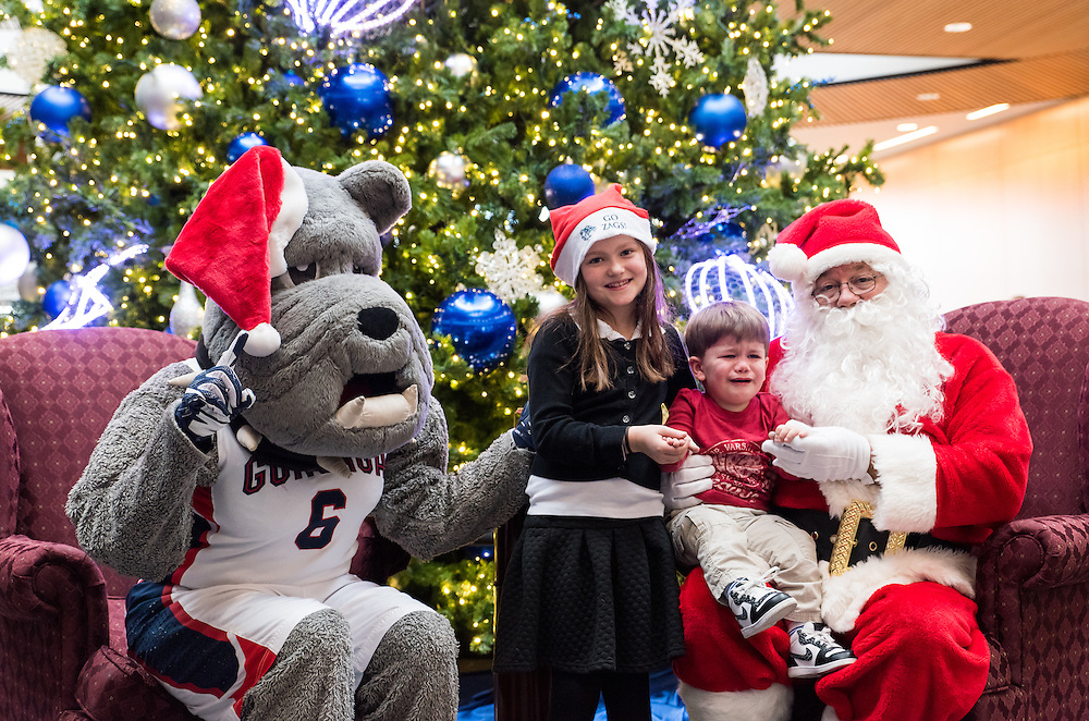 Gonzaga students and families got their pictures taken with Santa and Spike on Dec. 4. (Photo by Edward Bell)