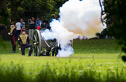 Green Park, London, June 11th 2016. Marking Her Majesty The Queen's official birthday, the Royal King's Horse Artillery fires a 41-Gun-Salute in Green Park. PICTURED: A blast of hot flame and smoke erupts from the barrel of a gun.