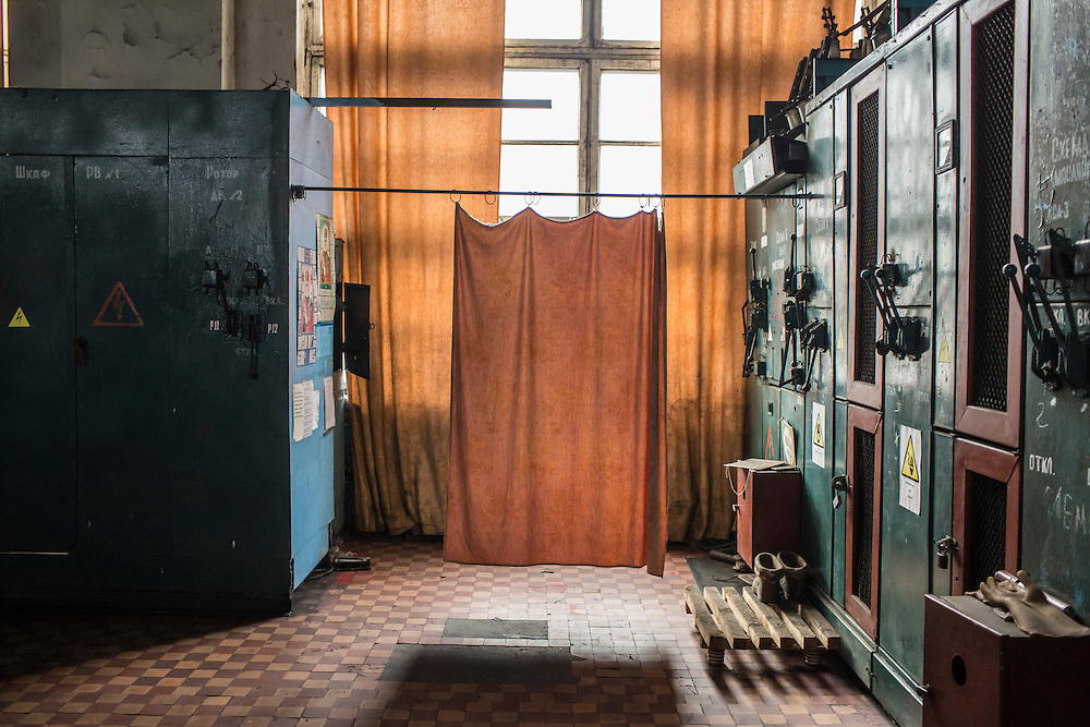 A curtain hangs inside a room that controls the elevators at the Zolote Coal Mine on Tuesday, February 9, 2016 in Zolote, Ukraine. The mine is one of the oldest in the region, having first opened in 1905.