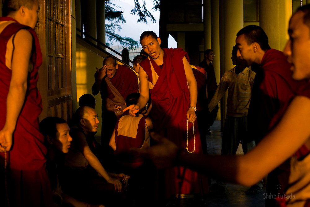 Monks practice debating ritual at the Namgyal Monastery, opposite the Dalai Lama's residence in McLeod Ganj, Dharamsala, India, where the Dalai Lama settled after fleeing Tibet in 1959 after a failed uprising against Chinese rule, June 3, 2009.