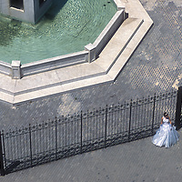 Seen from above, a bride poses in front of a fountain in Havana, Cuba.