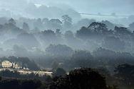 Misty morning sunrise over Dartmoor, South Devon, England.