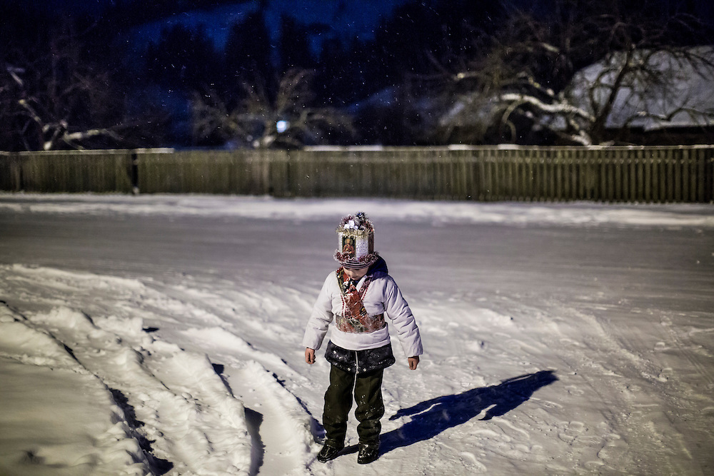 ILTSI, UKRAINE - JANUARY 6: Stas Mahulia, 5, during a pause while caroling door to door in celebration of Orthodox Christmas on January 6, 2015 in Iltsi, Ukraine. While many of the traditions are similar across Ukraine, the songs and clothing of the Hutsul culture are common in the Carpathian Mountains. (Photo by Brendan Hoffman/Getty Images) *** Local Caption *** Stas Mahulia