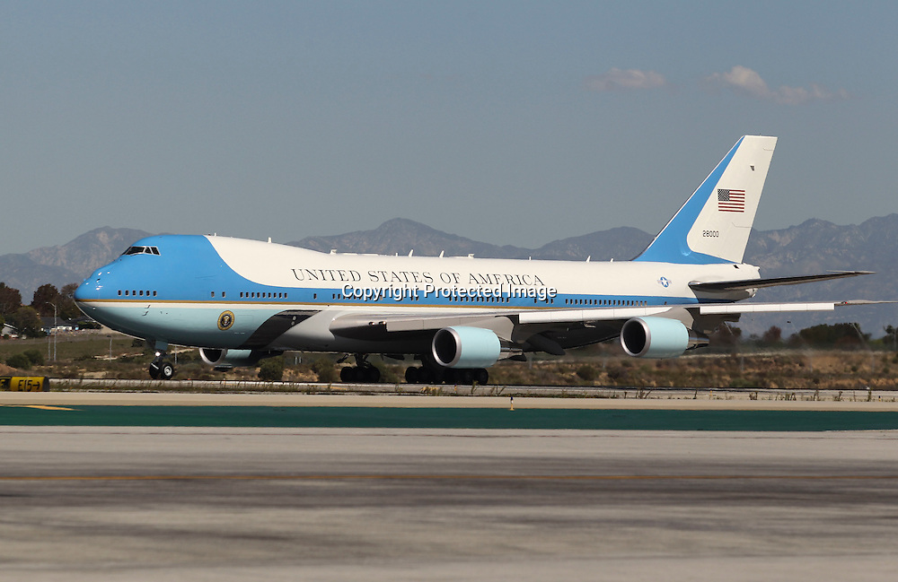 Air Force One, with President Barack Obama aboard, lands at Los Angeles International Airport in Los Angeles on Saturday, Oct. 10, 2015. (AP Photo/Ringo H.W. Chiu)