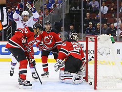 Oct 21, 2014; Newark, NJ, USA; New York Rangers left wing Chris Kreider (20) celebrates his goal on New Jersey Devils goalie Cory Schneider (35) during the first period at Prudential Center.